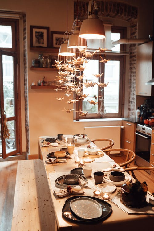 Table setting with dishware and decorations in apartment