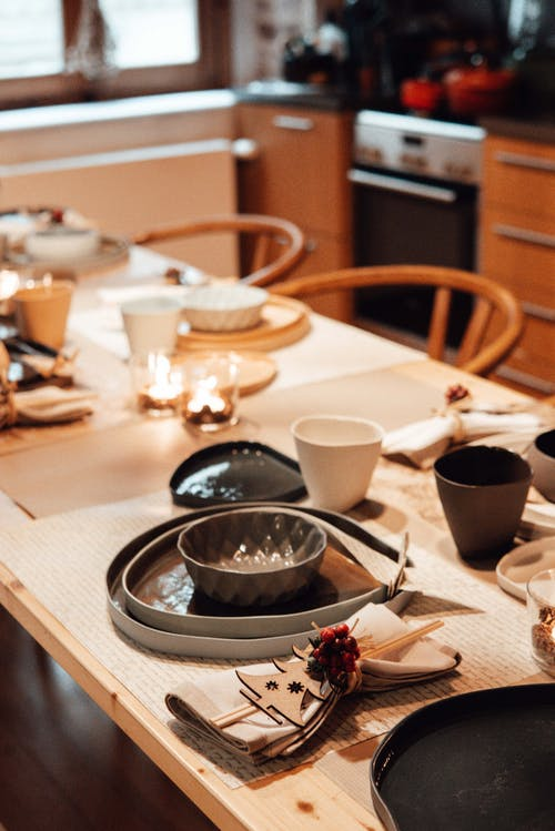 Dinner table with dishware in kitchen