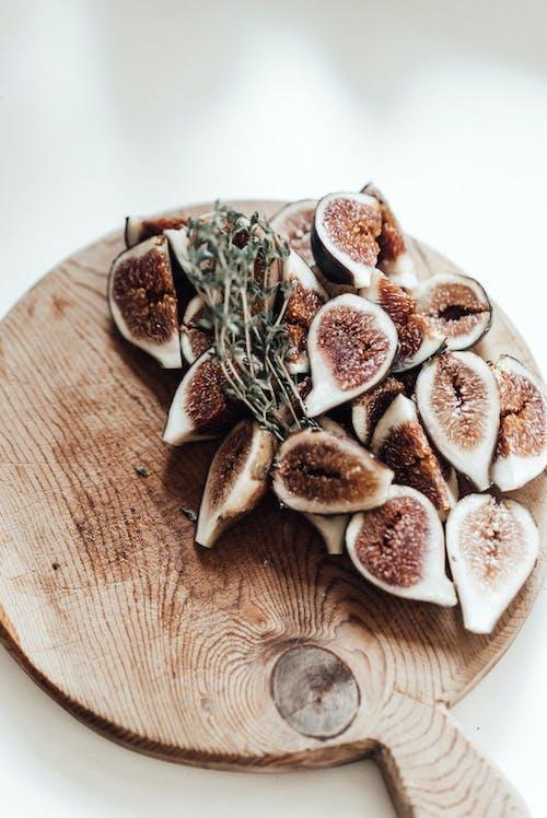 Ripe figs on wooden board