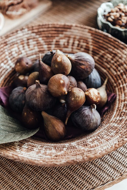 Bowl of figs on table