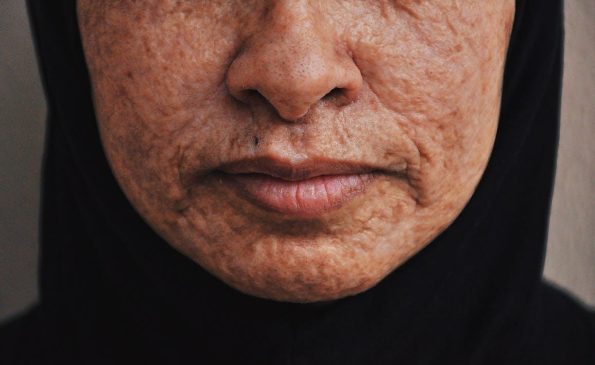 Crop mature ethnic woman in hijab