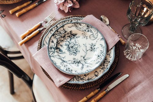 White and Blue Floral Ceramic Plate on Brown Wooden Table