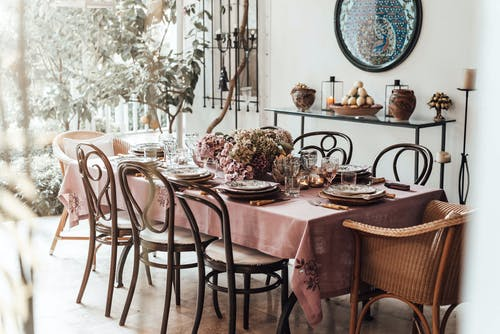 Dining room with served table decorated with flowers