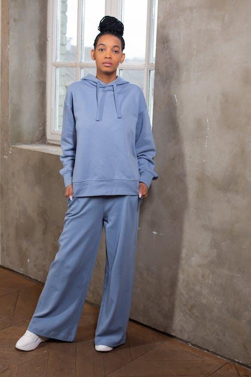 Serious black woman wearing blue sportswear