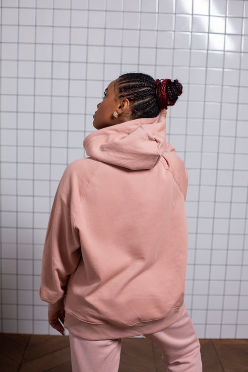 Dreamy woman in pink fashionable hoodie and trousers