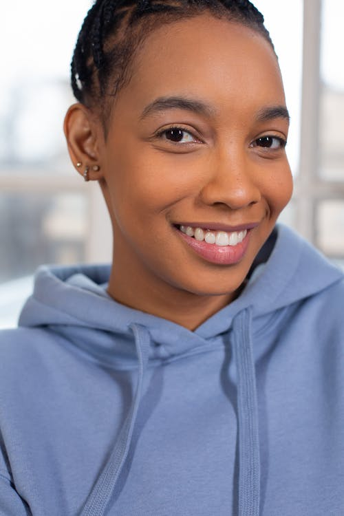 Smiling black woman in fashionable blue hoodie