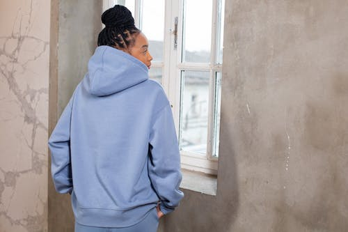 Young black woman in blue fashionable hoodie