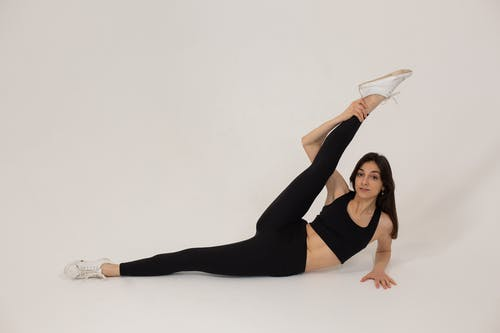 Fit woman practicing stretching in studio