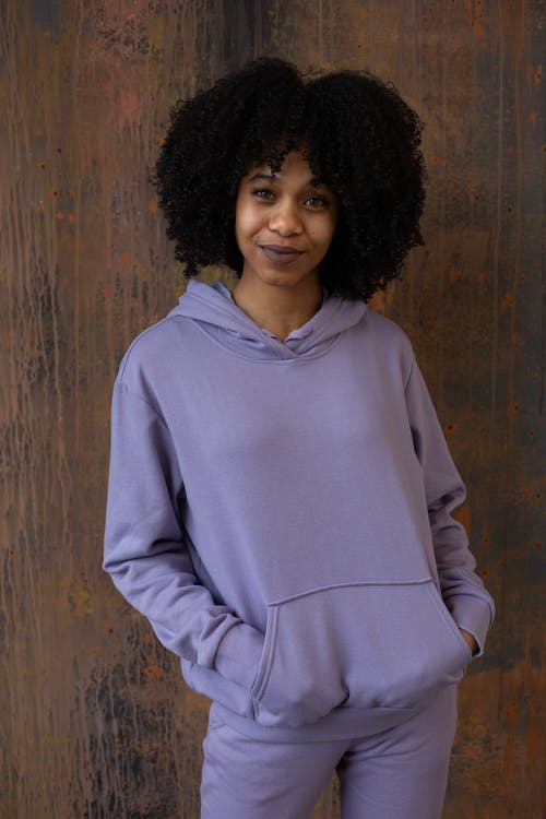 Smiling black woman in purple outfit