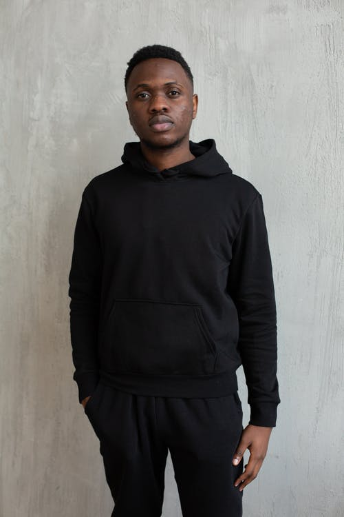 Serious black man wearing hoodie and sweatpants