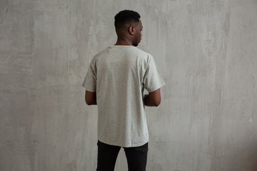 Black man in t shirt and jeans in studio