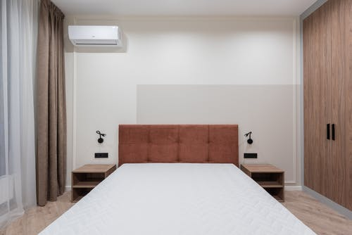 Interior of bedroom with big bed and wardrobe