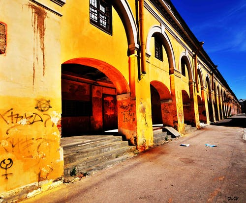 Free stock photo of colorful houses, deserted structure, street art, wall