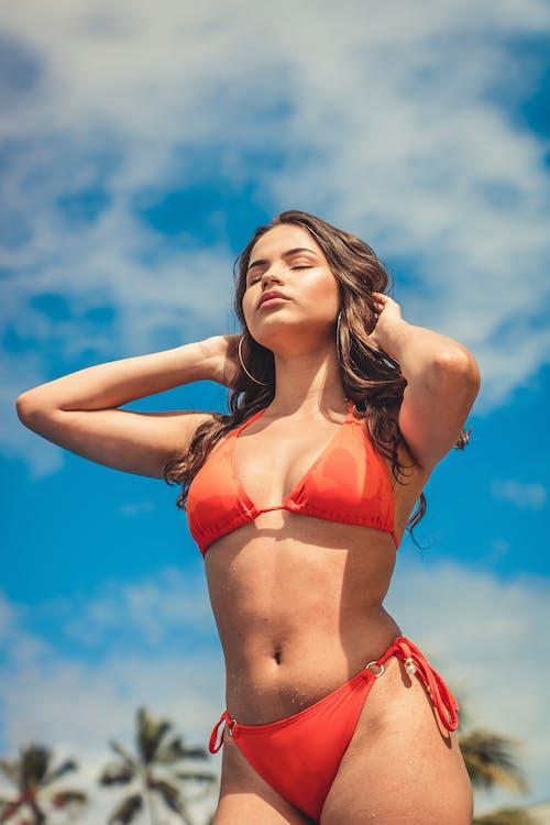 Slim woman in swimsuit in tropical resort