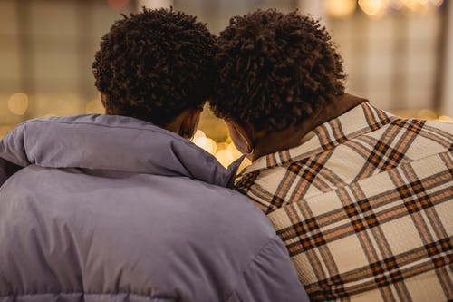 Black couple of gays leaning heads