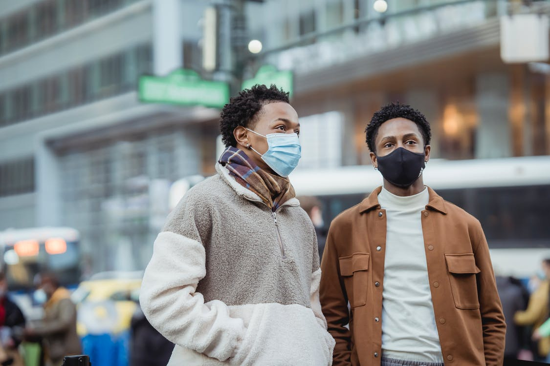 Black couple in medical masks on street