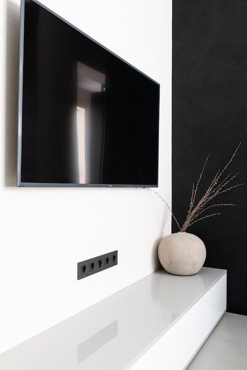 Modern TV set hanging on wall