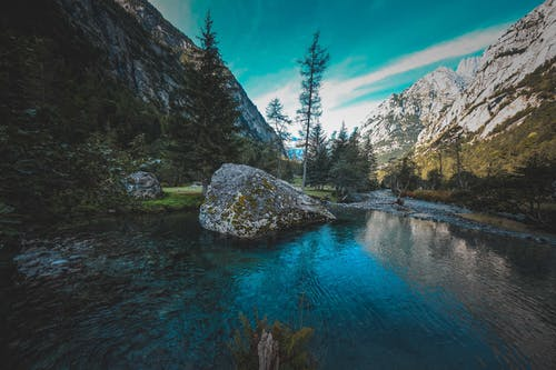 Peaceful lake amidst rocky mountains in wild valley