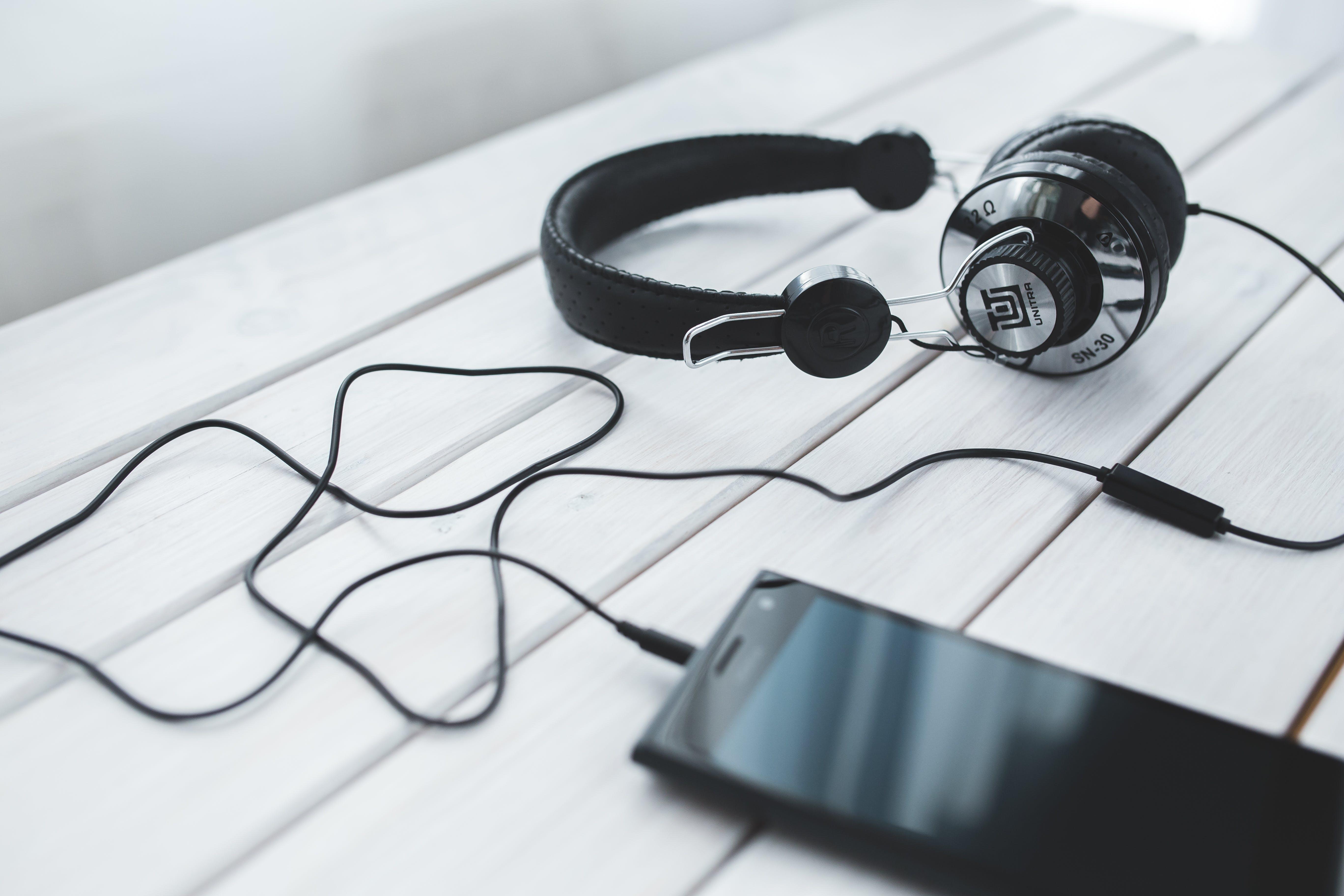 Black vintage headphones with mobile smartphone