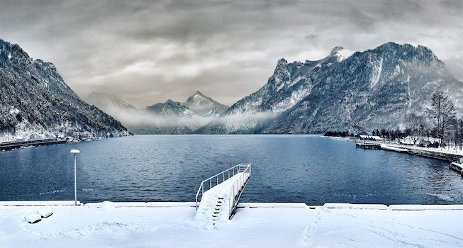 Dock Covered With Snow Near Lake