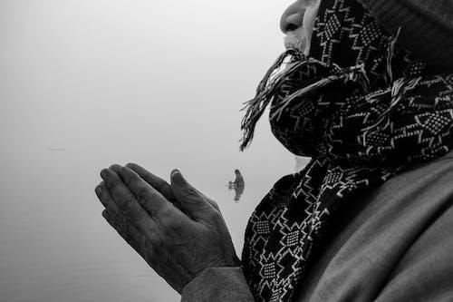 Close Up Photo of Praying Hands
