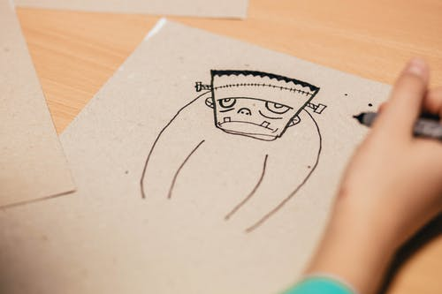 Kid Draws Cartoon Character Figure