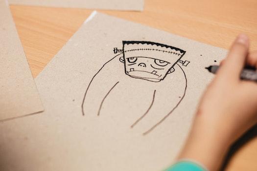 Kid Draws Cartoon Character Figure