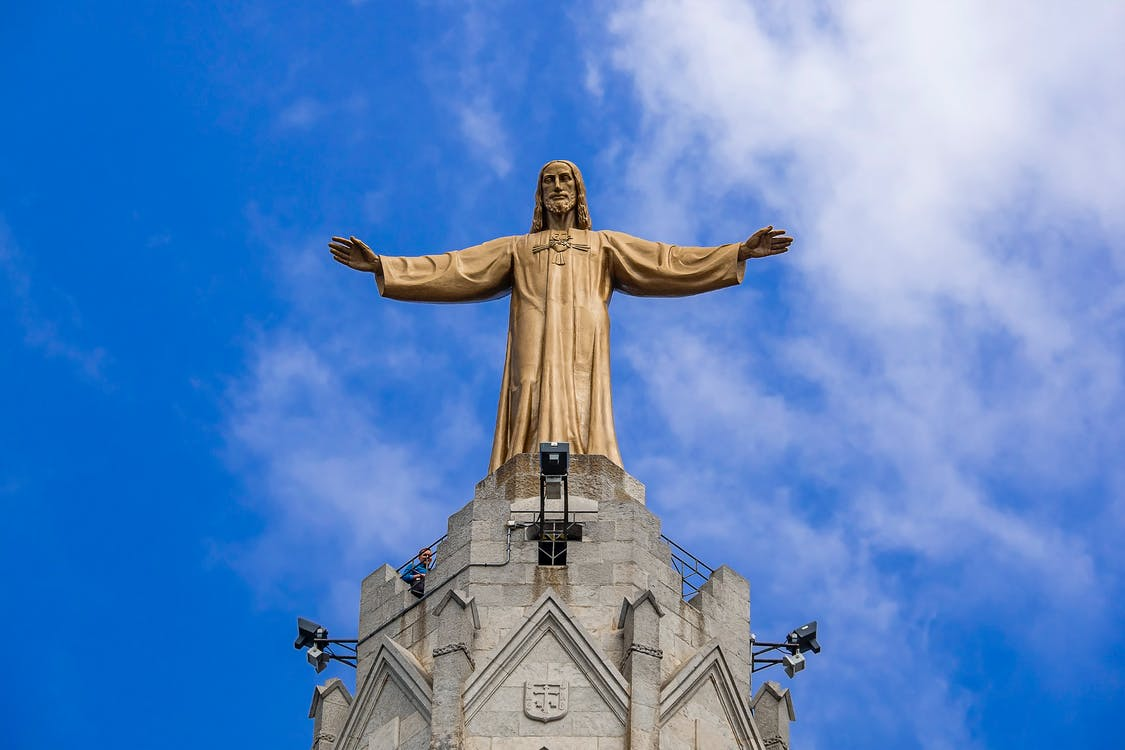 Gold Statue Under Blue Sky