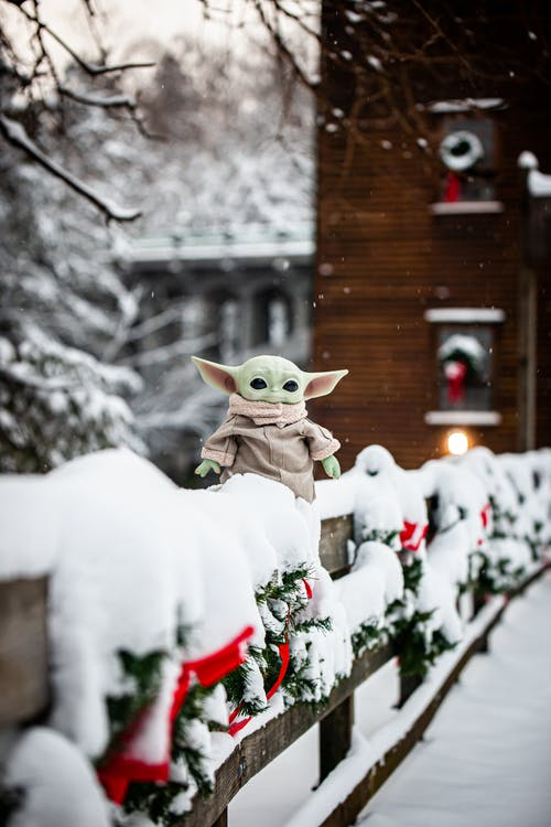 A Toy Yoda Out in the Snow