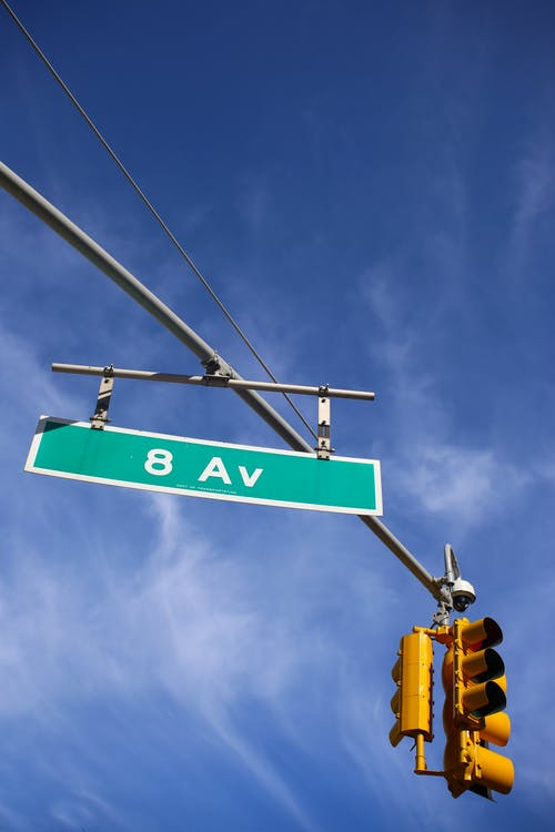 Free stock photo of 8th Avenue, blue and yellow, blue sky