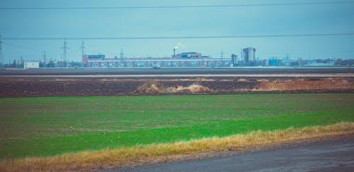 Бесплатное стоковое фото с город, поле, предприятие, работа