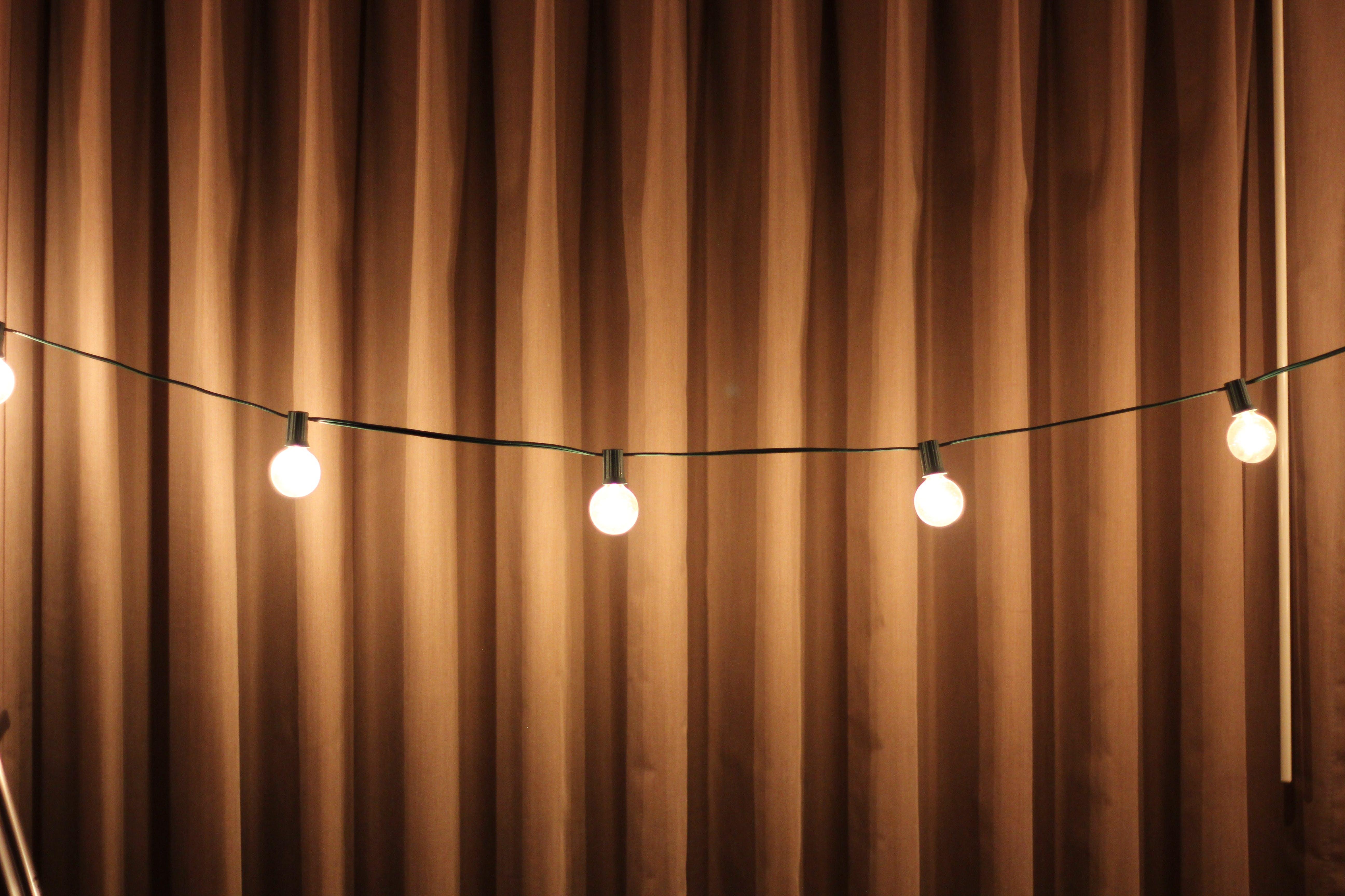 Black String Lights Beside Brown Curtain