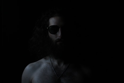 Grayscale Photography Of Topless Man Wearing Sunglasses