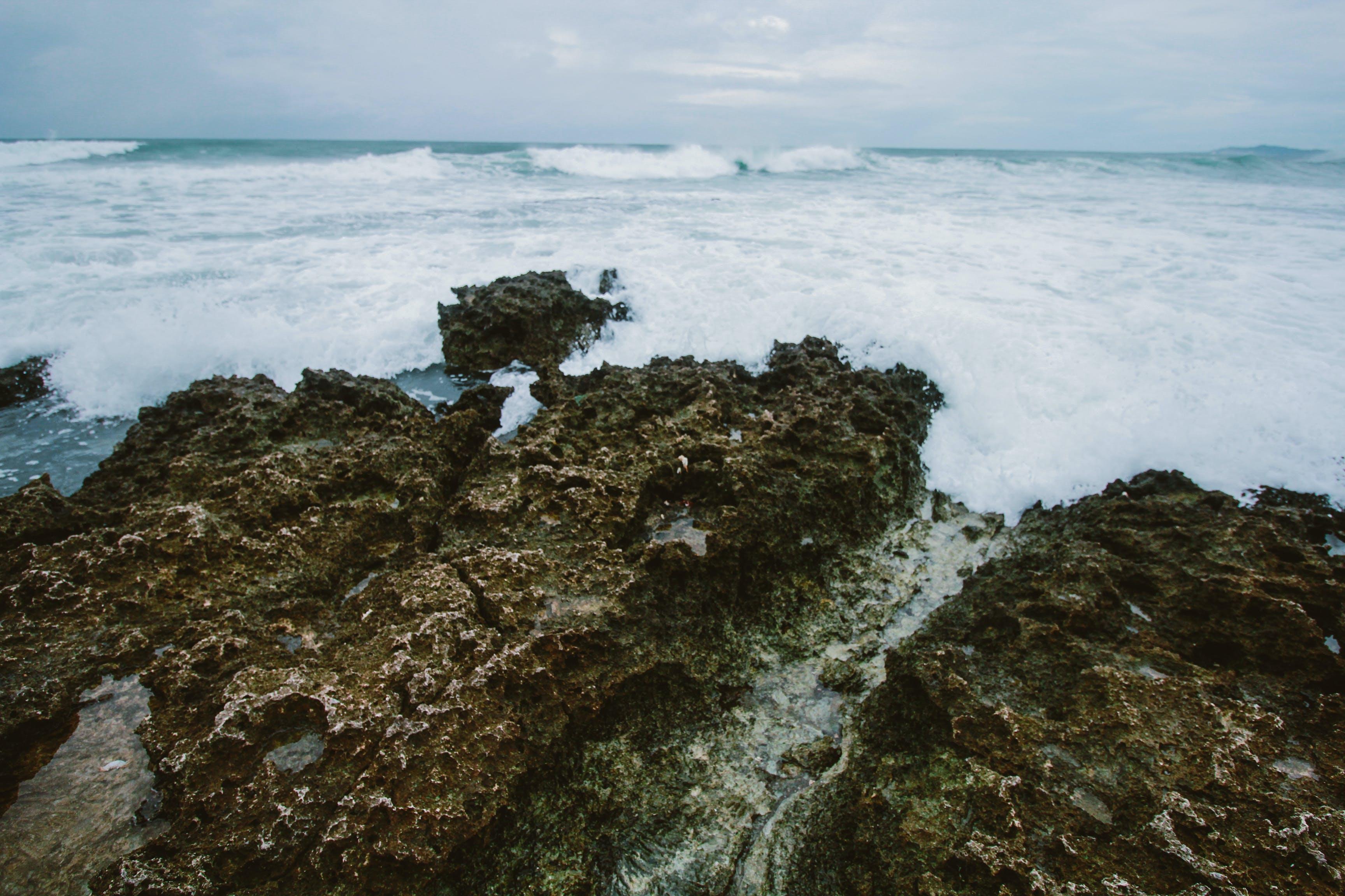 Gray Stone Near Body of Water
