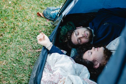 Young couple resting together in tent