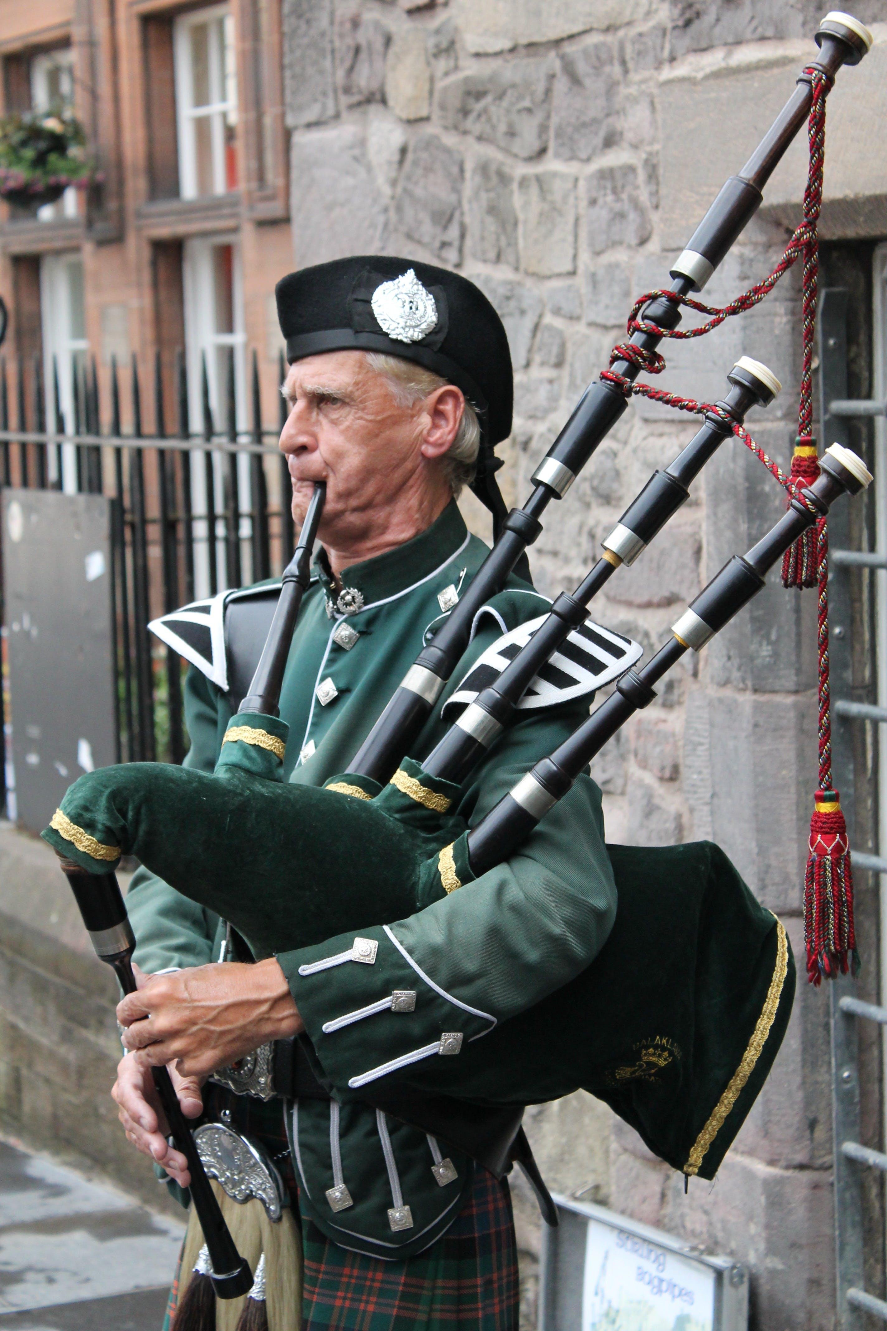 bagpiper, bagpipes, elderly man