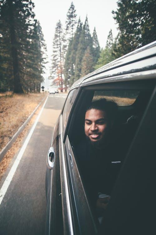 Man in Black Hoodie Standing on the Road
