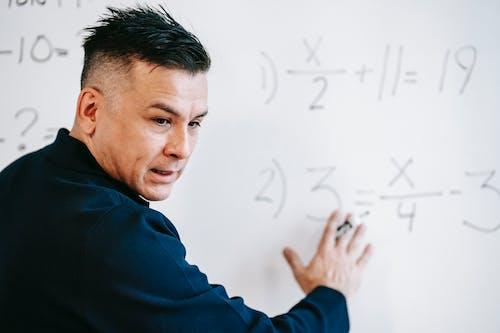 Photo Of Man Explaining Lesson