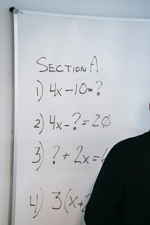 Photo Of Math Equations Written On Whiteboard