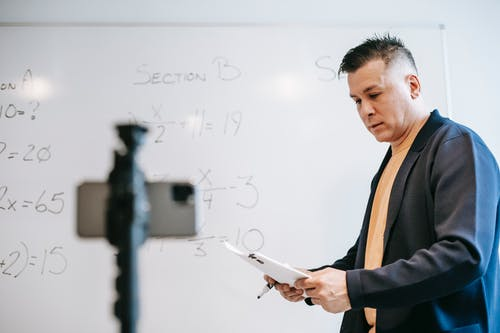 Photo Of Man Discussing Lessons