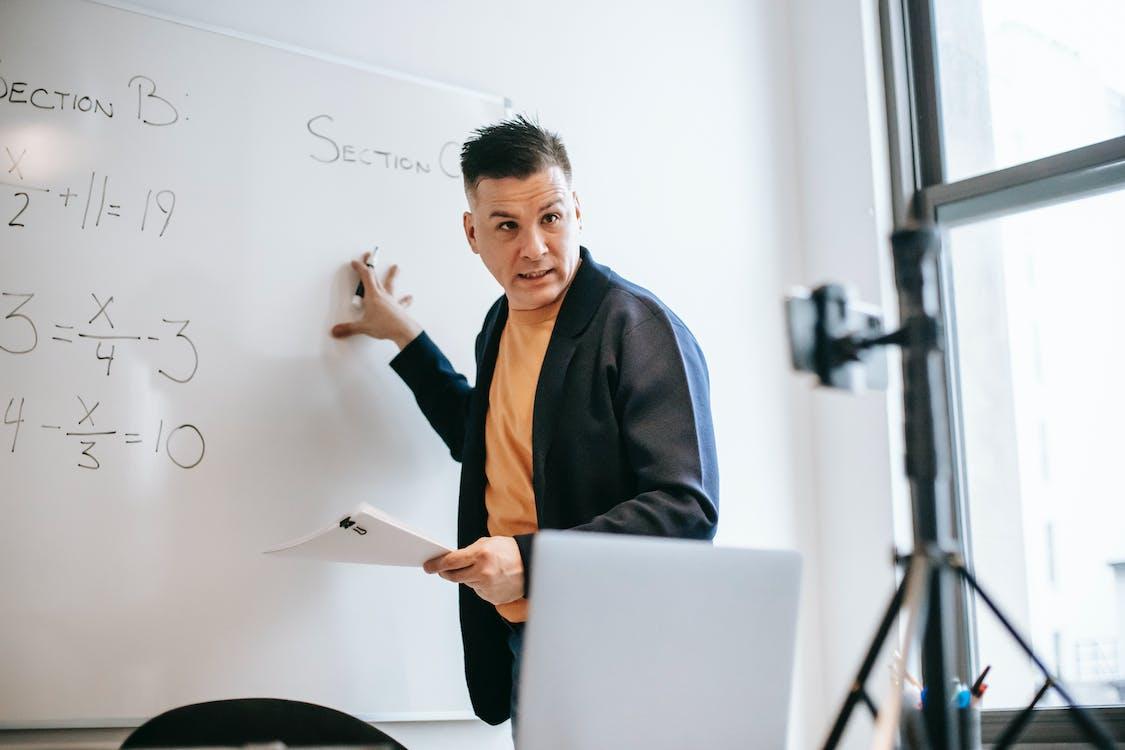 Photo Of Man Teaching Via Smartphone