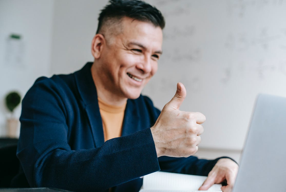 Photo Of Man Doing Thumbs Up Hand Gesture caused by good email marketing subject lines