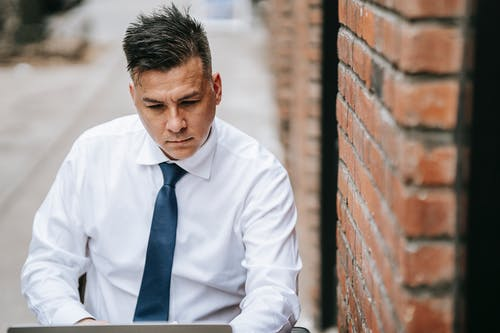 Photo Of Man Looking Steadily In His Laptop