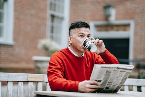 Photo Of Man Drinking Hot Beverage