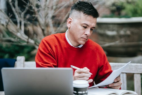 Photo Of Man Reviewing Documents
