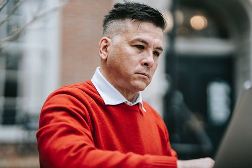 Close-Up Photo Of Man Wearing Red Sweater