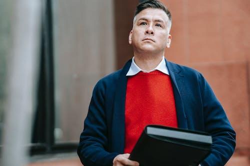 Photo Of Man Carrying Black Envelope