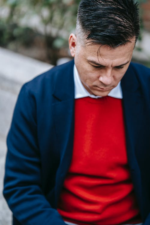 Close-Up Photo Of Man Wearing Blue Blazer