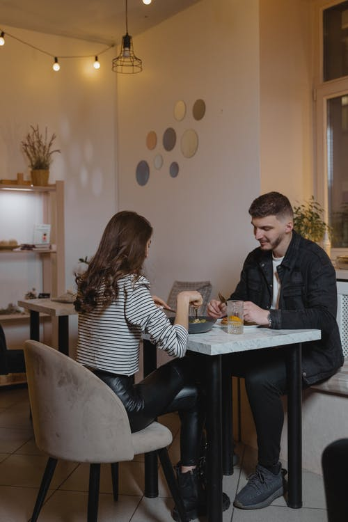 Man and Woman Dating In A Café