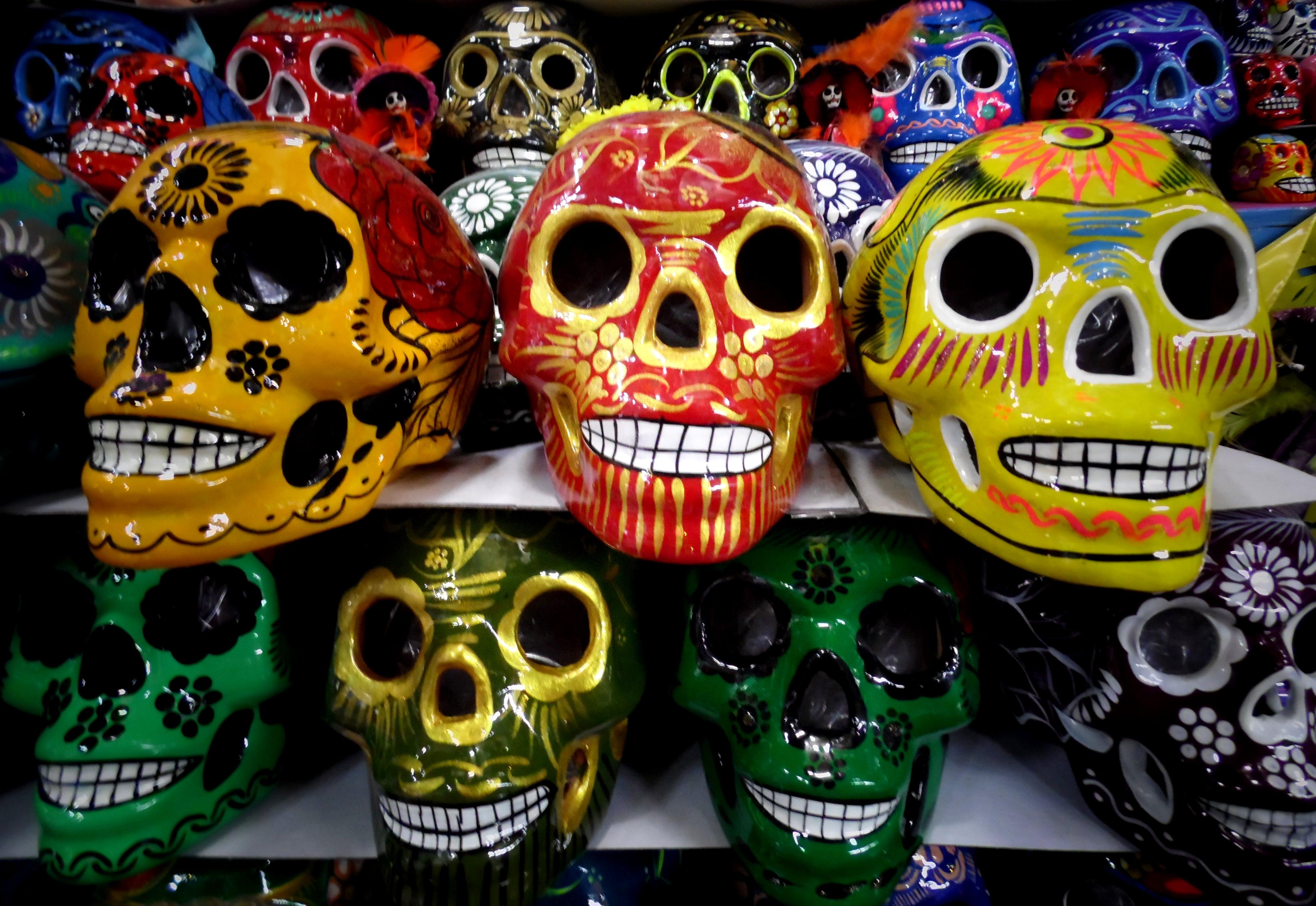 Seven Assorted-color Skullcandy Figurines